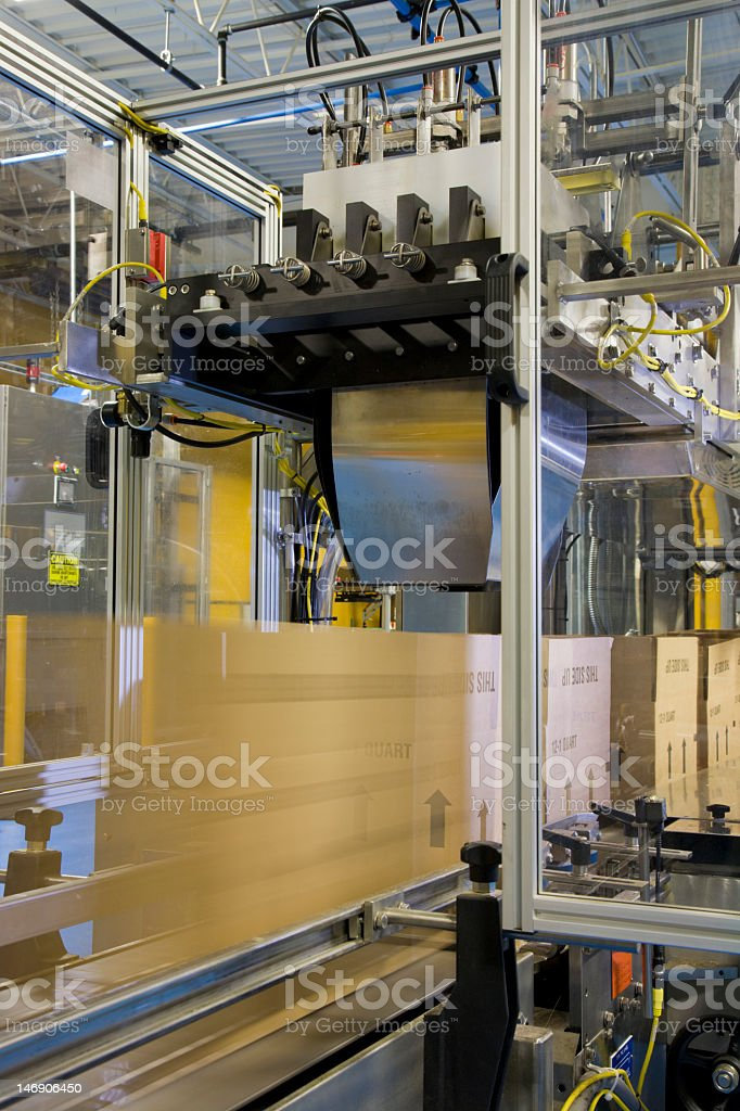 Factory packaging line with large boxes royalty-free stock photo