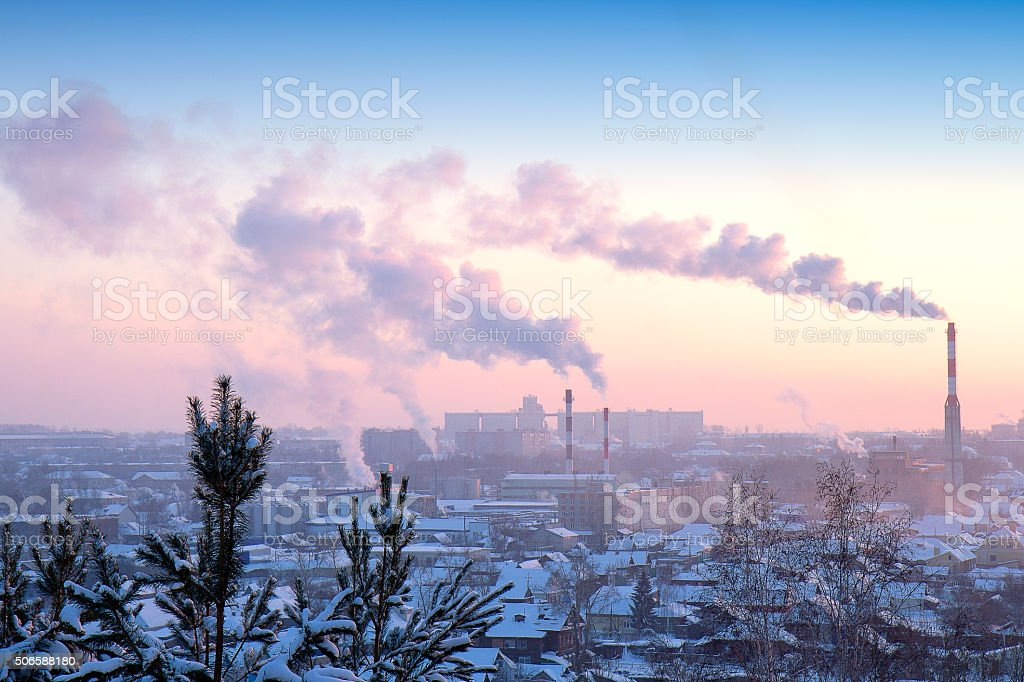 factory pipes on a background of the city stock photo