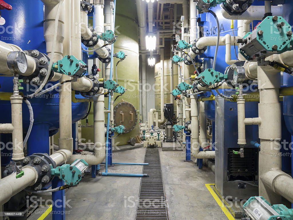 A factory room with multiple machines stock photo