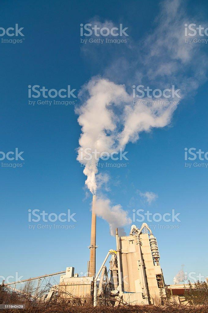 Factory with Smokestacks and Blue Sky stock photo