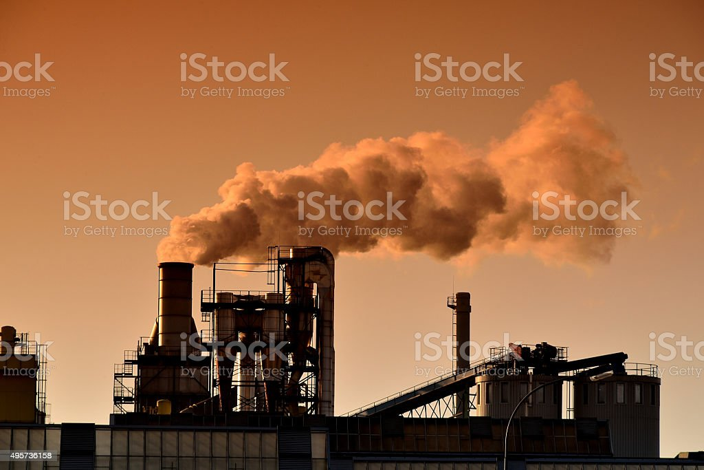 Factory with smoking chimney stock photo