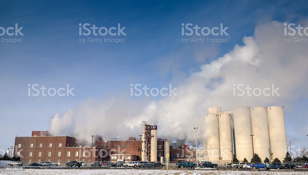 Factory with steam stacks in a cold morning royalty-free stock photo