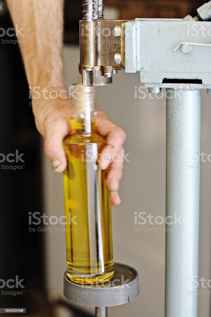 Factory worker corking bottle stock photo