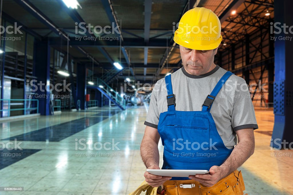 Factory worker using digital tablet stock photo
