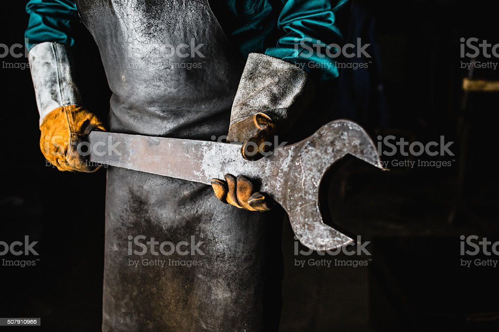 Factory worker with large wrench stock photo