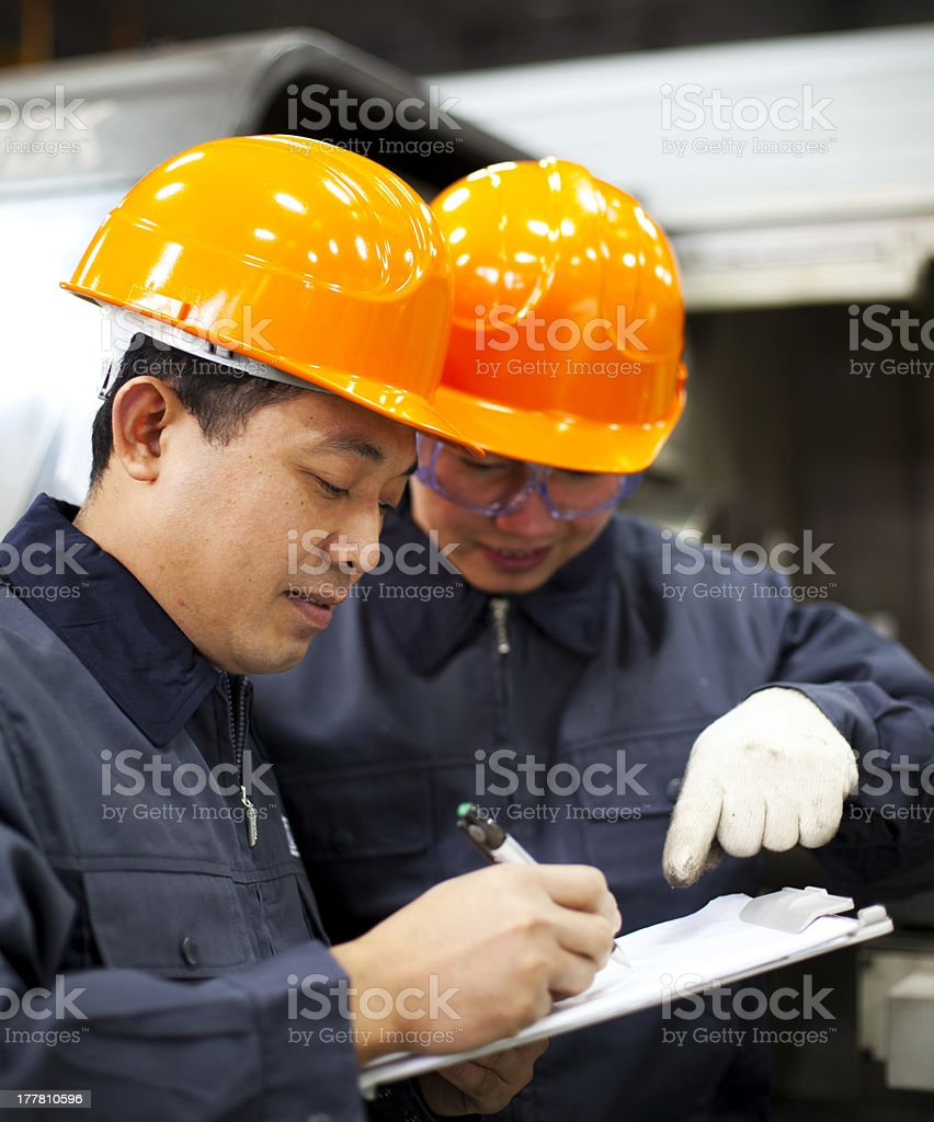 Factory workers discussion royalty-free stock photo