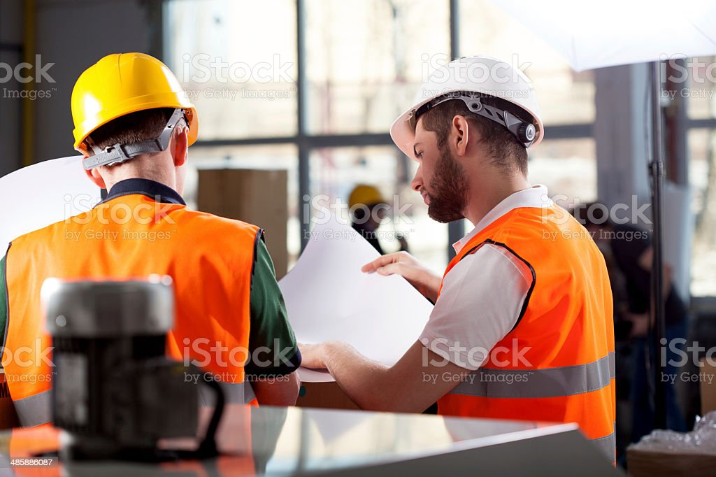 Factory workers planning stock photo