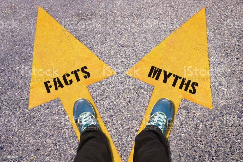 Facts and Myths painted on road stock photo