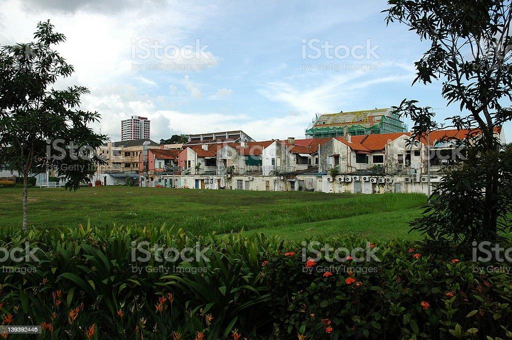 Faded buildings in beautiful surroundings stock photo