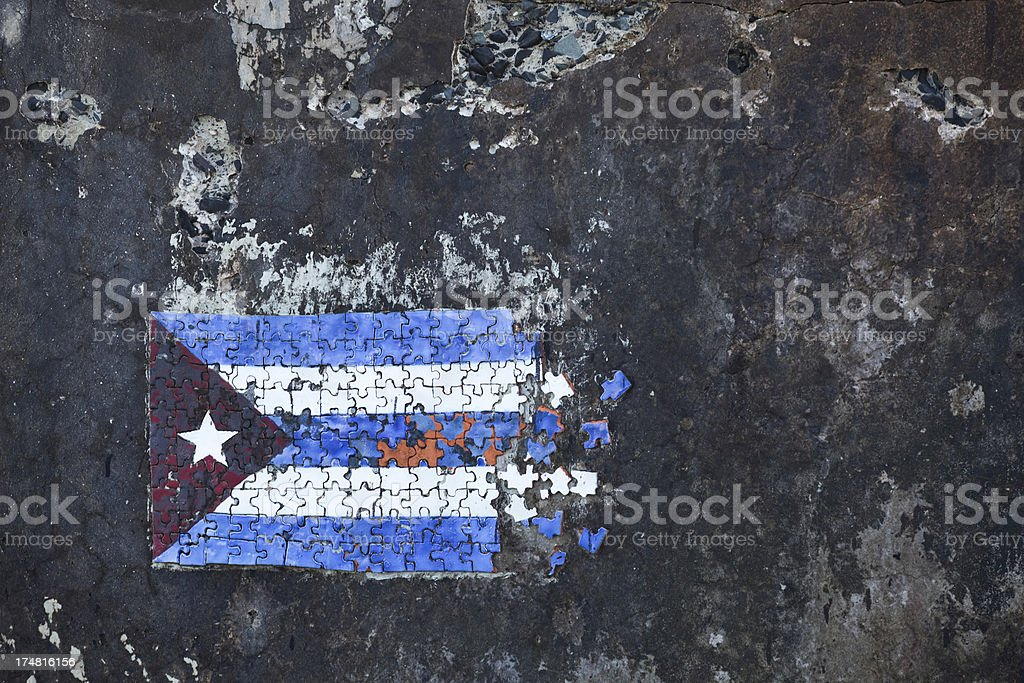 Faded Glory Cuban Flag painted on the Malec?n Sea Wall royalty-free stock photo