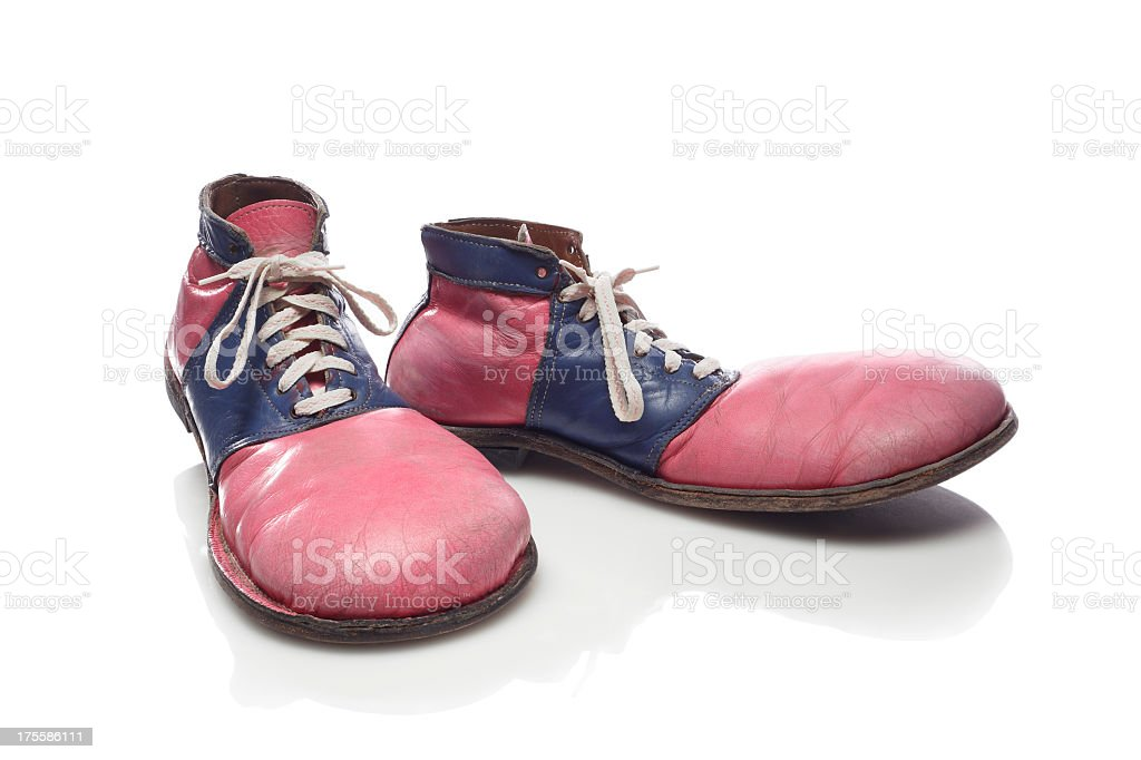 Faded red and blue clown shoes stock photo