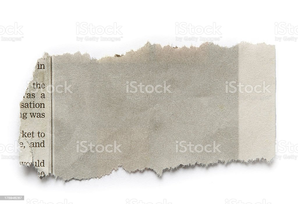 Faded scrap of newspaper on white background stock photo