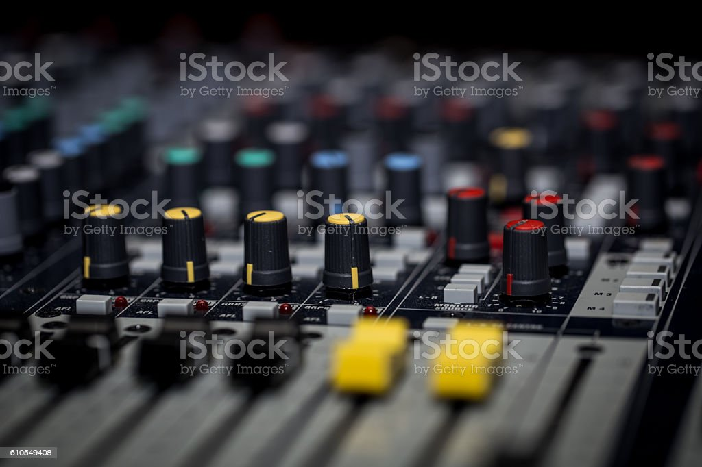 fader digital mixing console with volume meter stock photo