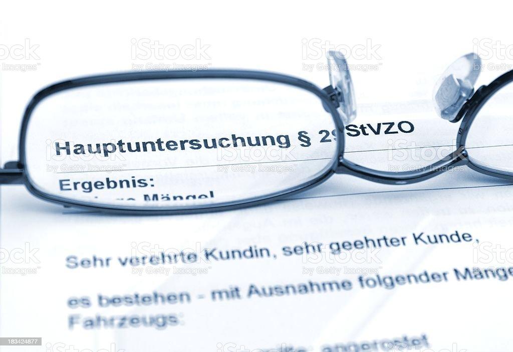Fahrzeug Hauptuntersuchung  -Tüv,  Glasses on german document stock photo