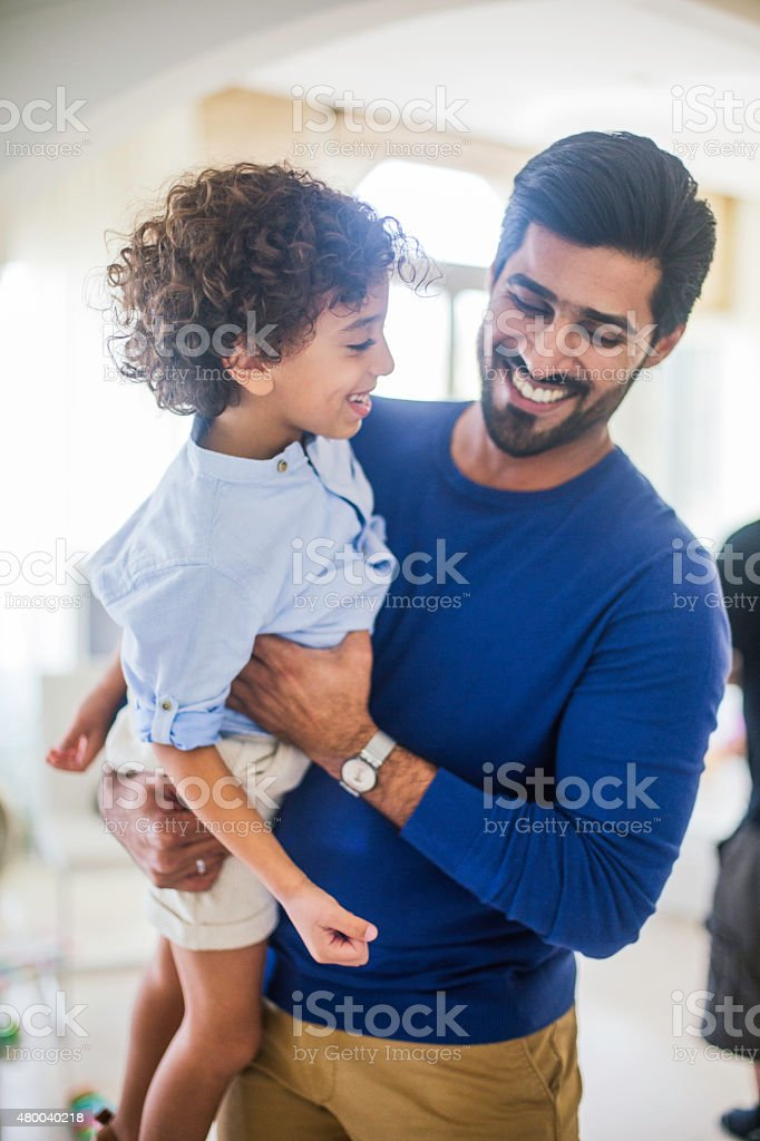 Fahter and son at home in Dubai. stock photo