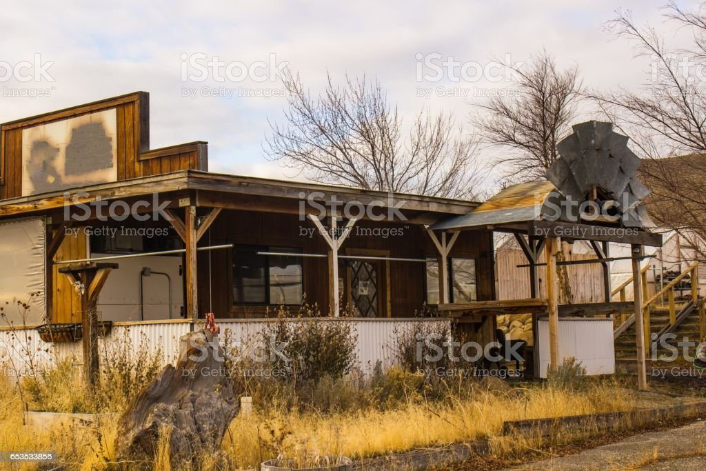 Failed Business Building With Half Windmill stock photo