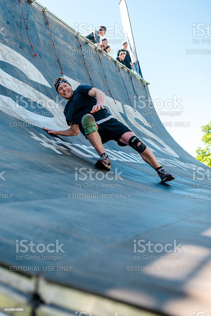 Failing to overcome wall on obstacle course race stock photo