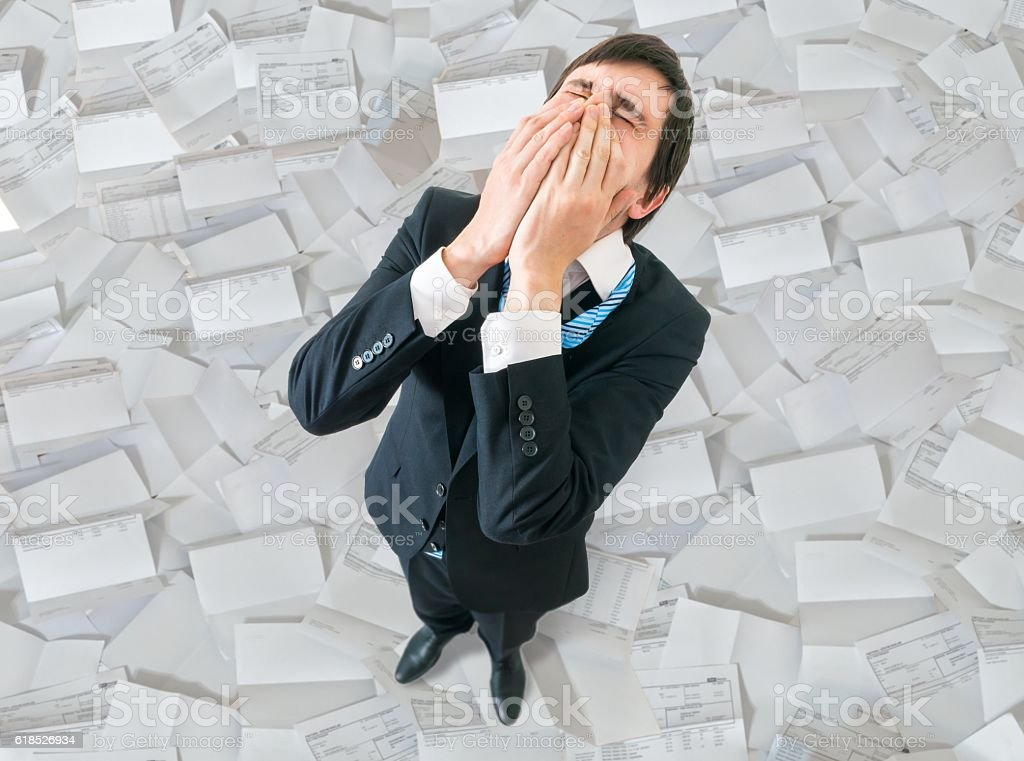 Failure and disappointment concept. Unhappy businessman from top. stock photo