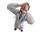 Failure and malpractice concept. Disappointed and stressed doctor.