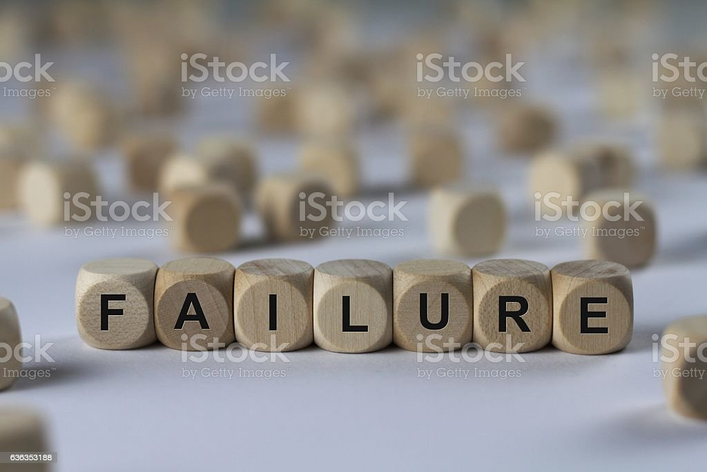 failure - cube with letters, sign with wooden cubes stock photo