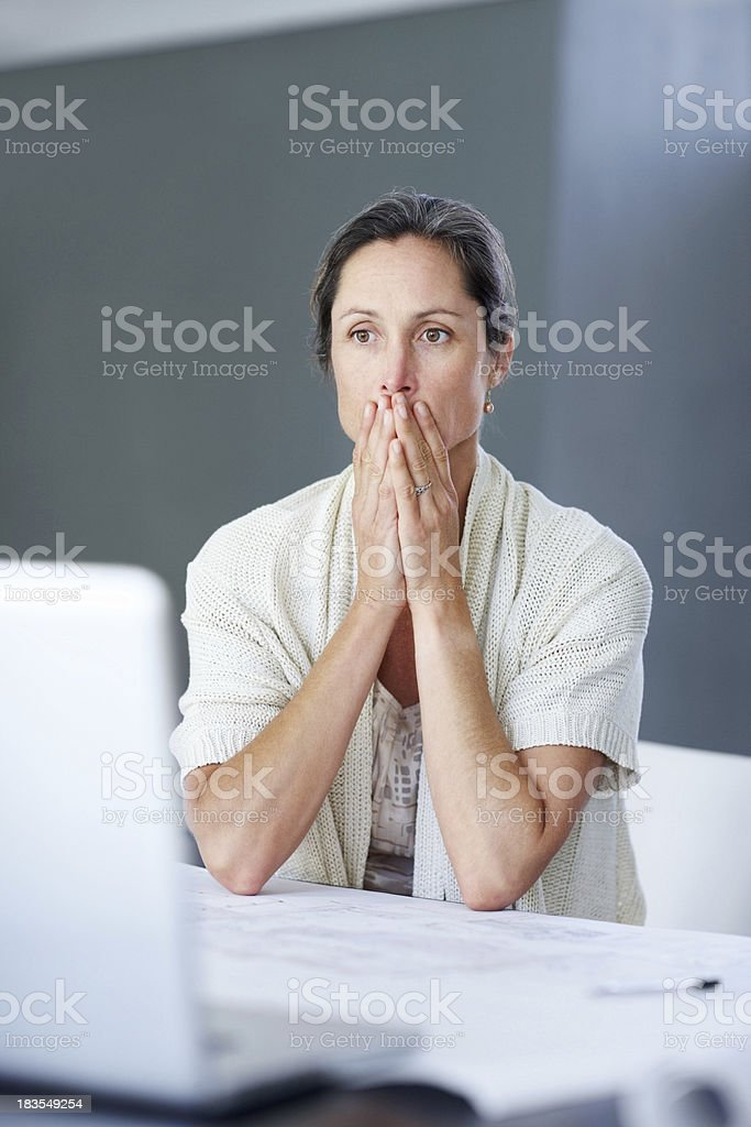 Failure - Disappointed mature businessswoman thinking royalty-free stock photo