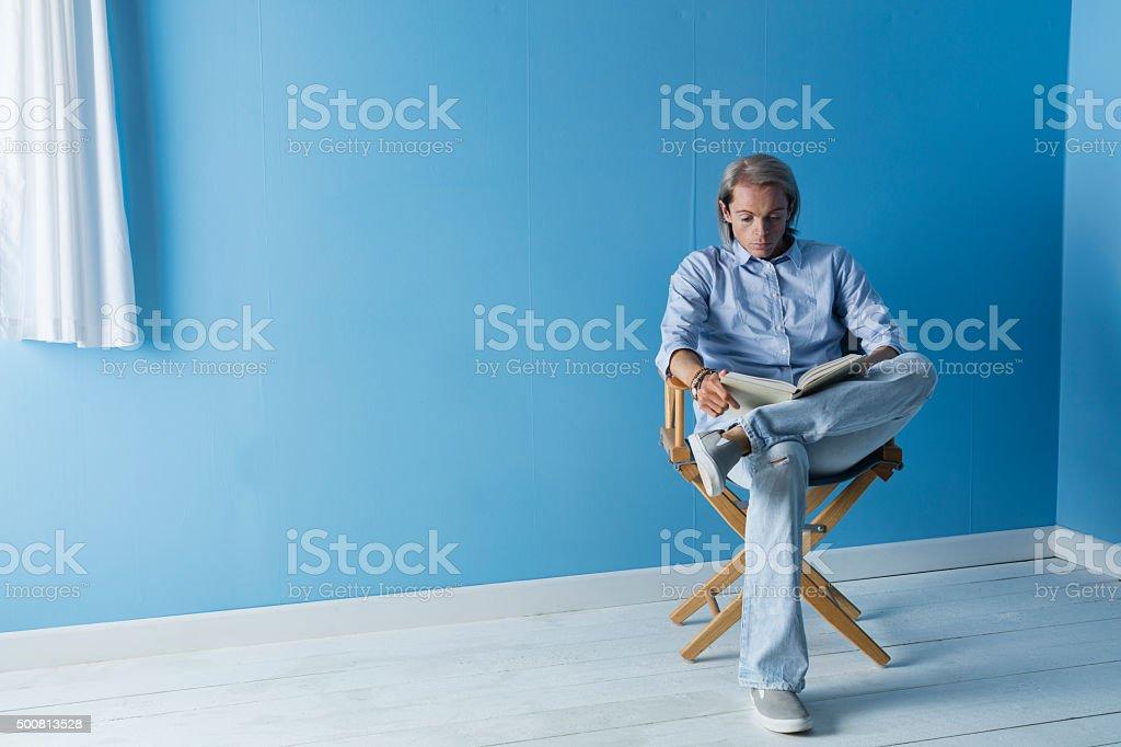 Fair Haired Man Reading A Book stock photo
