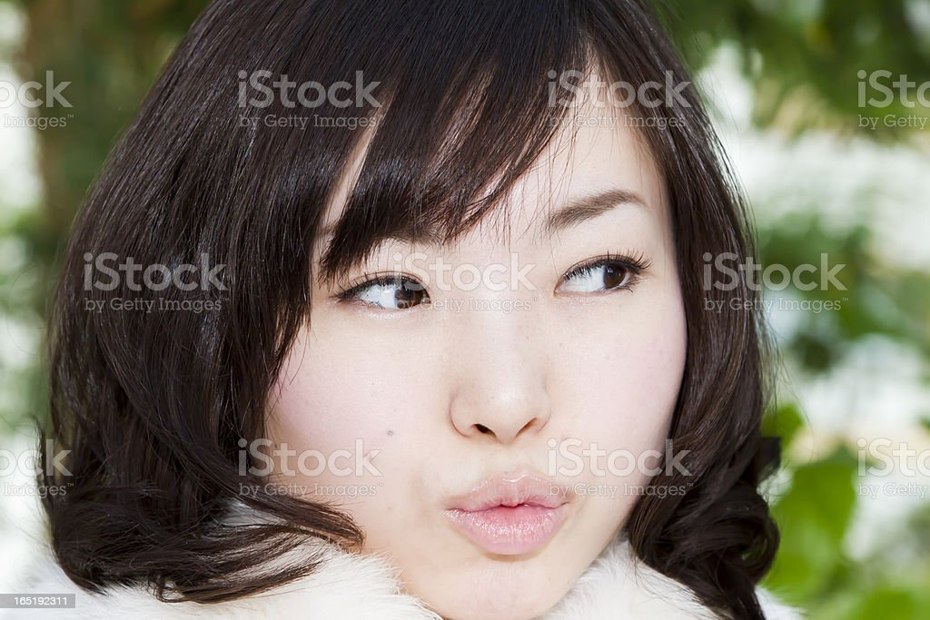 Fair Skinned Japanese Woman Pursing Lips royalty-free stock photo