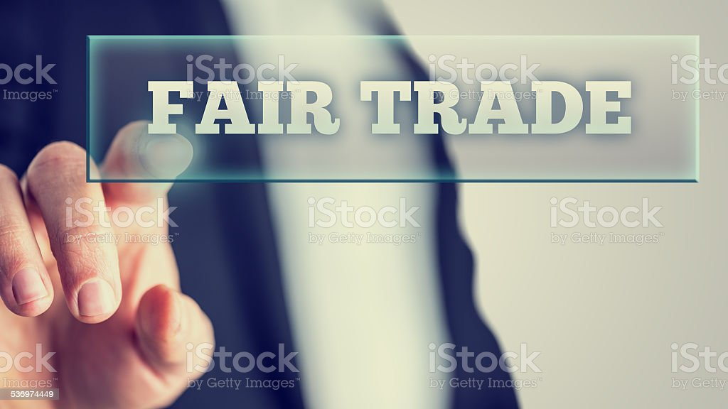 Fair Trade White Texts on Glass stock photo