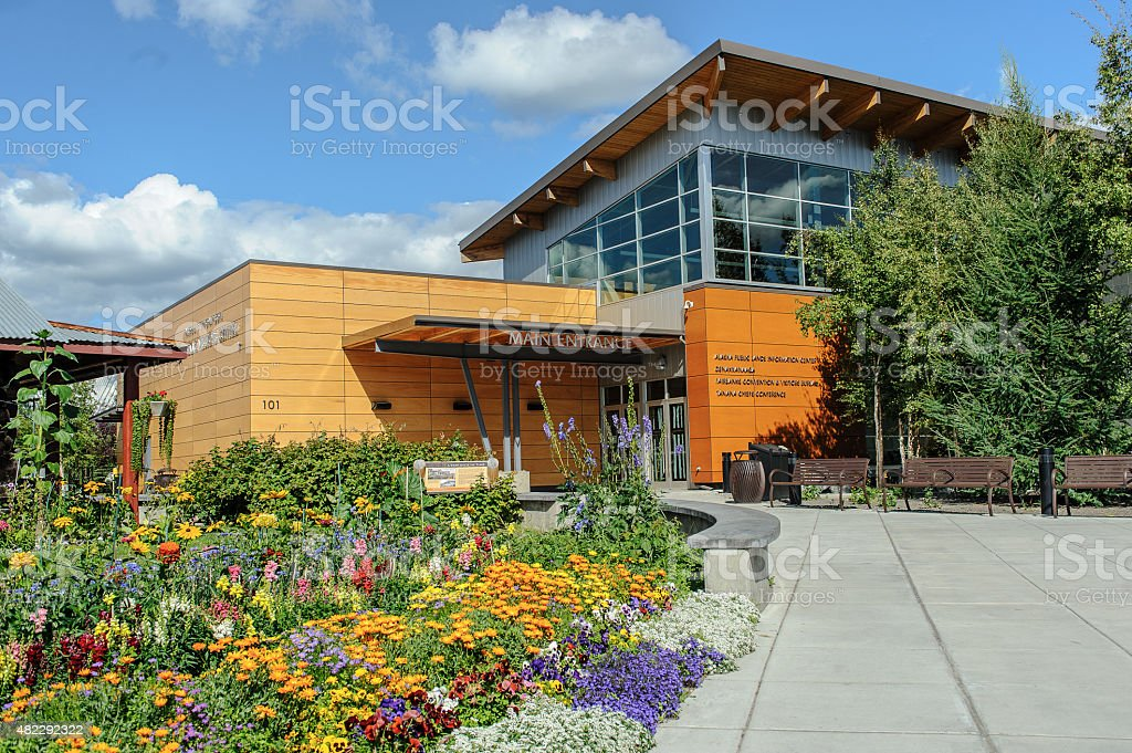 Fairbanks Visitor Center with summer flowers stock photo
