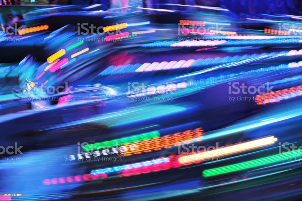 Fairground lights ride moving fast stock photo