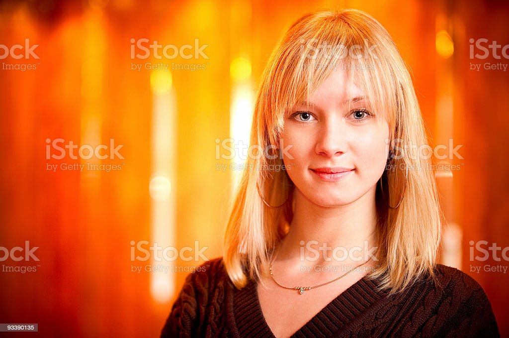 Fair-haired girl smiles royalty-free stock photo