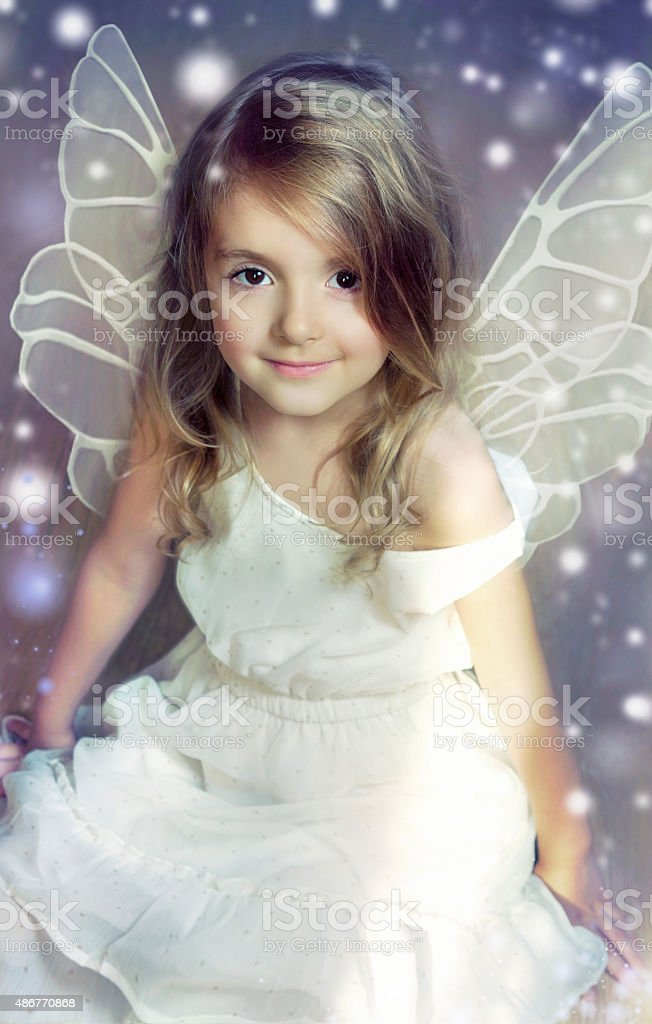 Fairy angel child girl with wings. stock photo