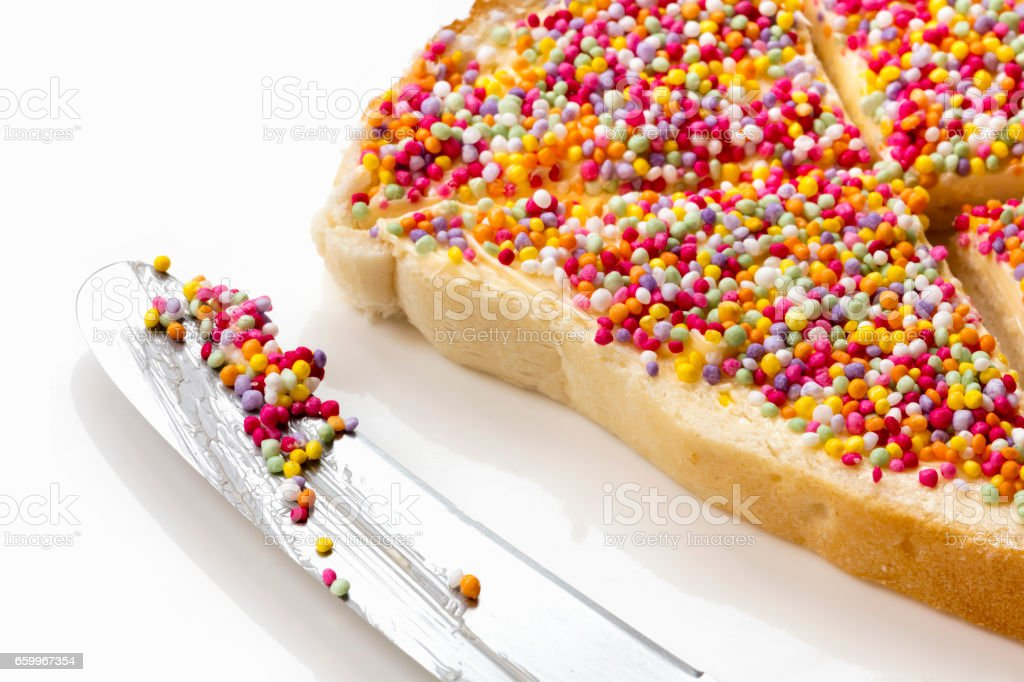 Fairy Bread with Butter Knife Side View stock photo