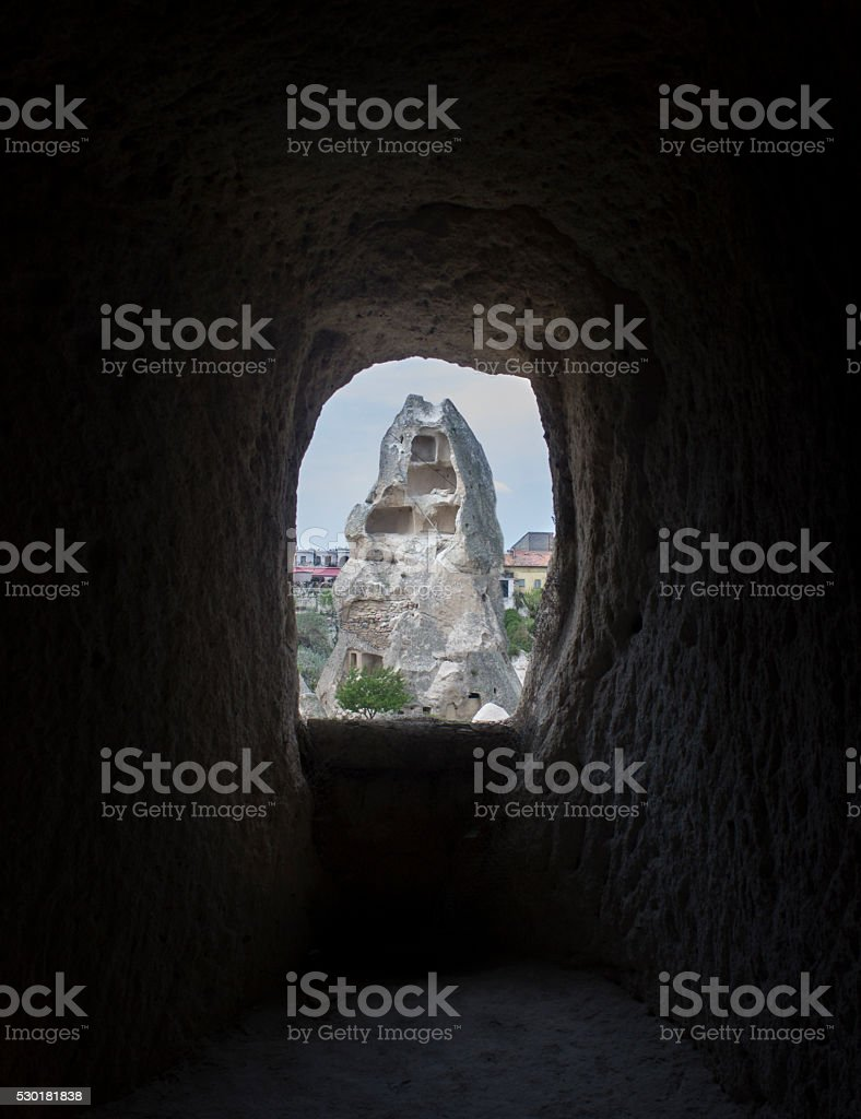 Fairy chimneys from inside of a cave in Cappadocia, Turkey stock photo