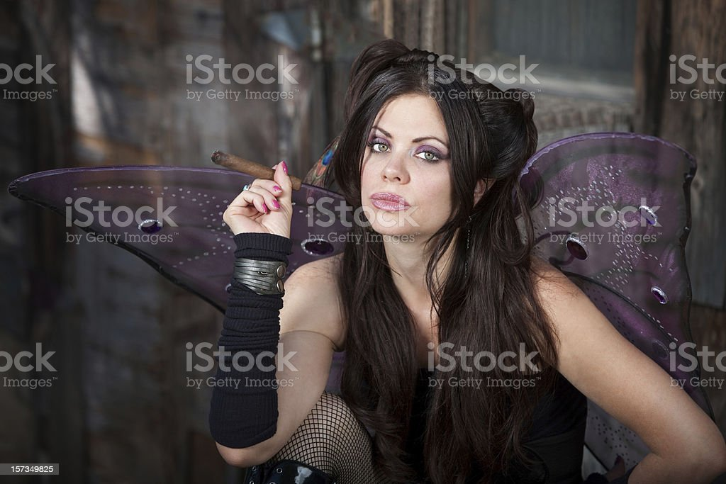 Fairy Holds a Cigar royalty-free stock photo