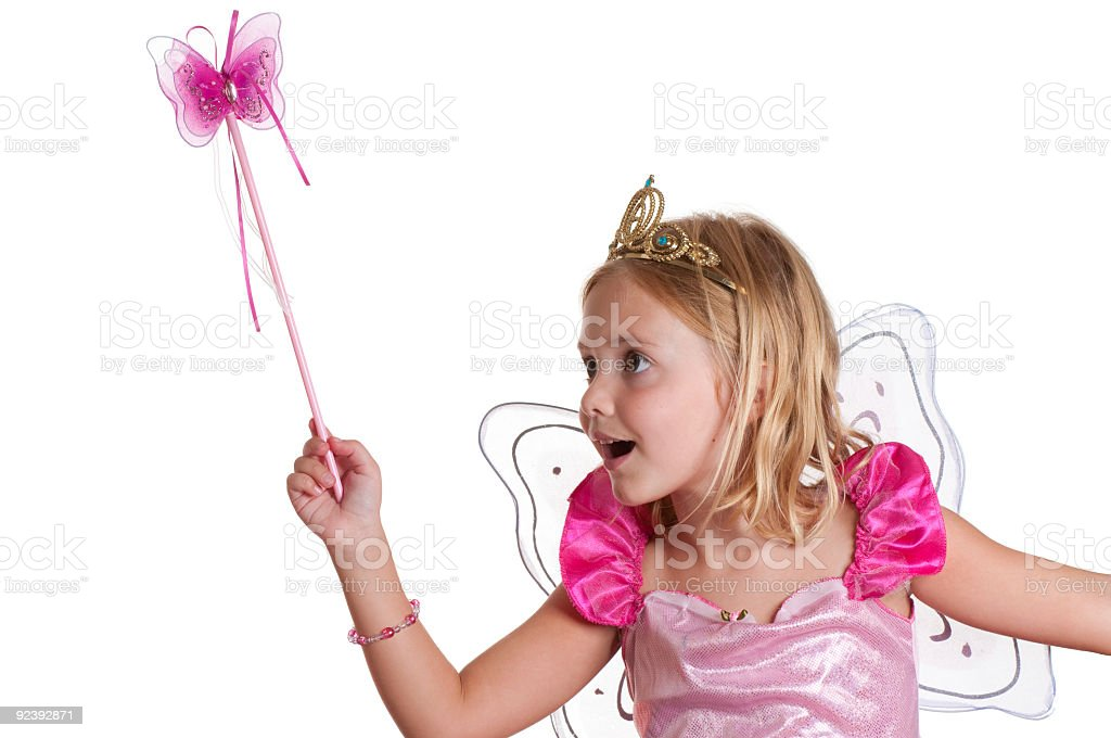 Fairy princess works her magic. stock photo