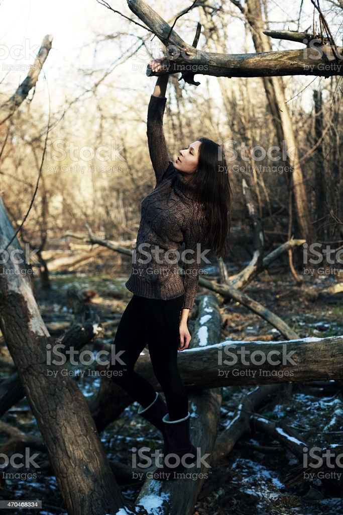 Fairy tale. Princess in a mystical garden pensively looking down stock photo