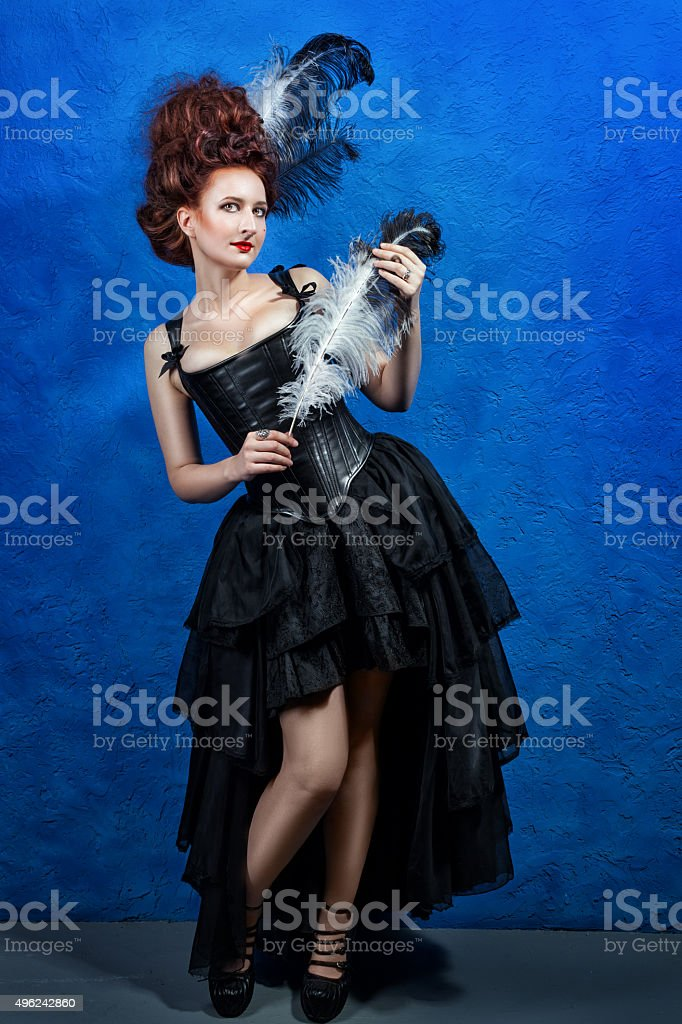 Fairy-tale image of a girl with  stylus to write. stock photo