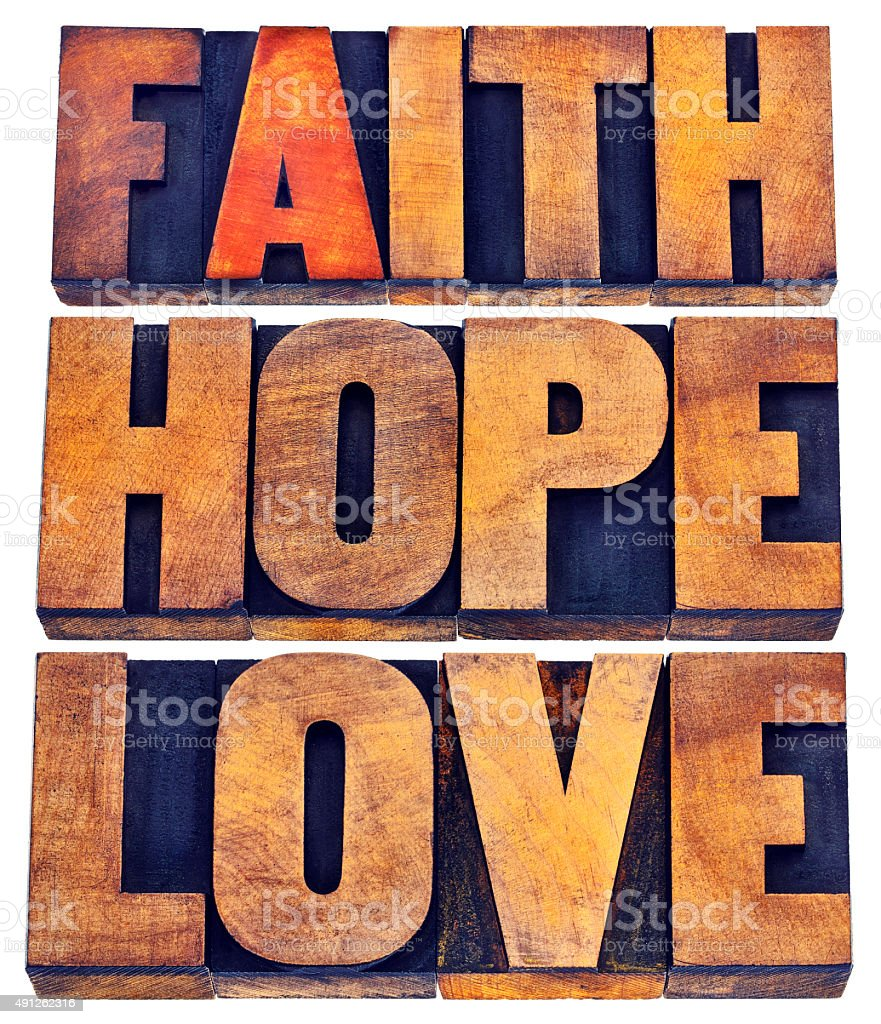 faith, hope and love typography stock photo