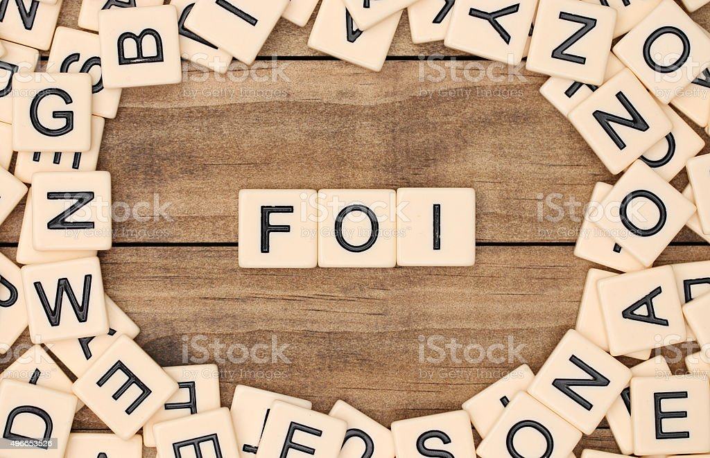 Faith in French spelled out in tan tile letters stock photo
