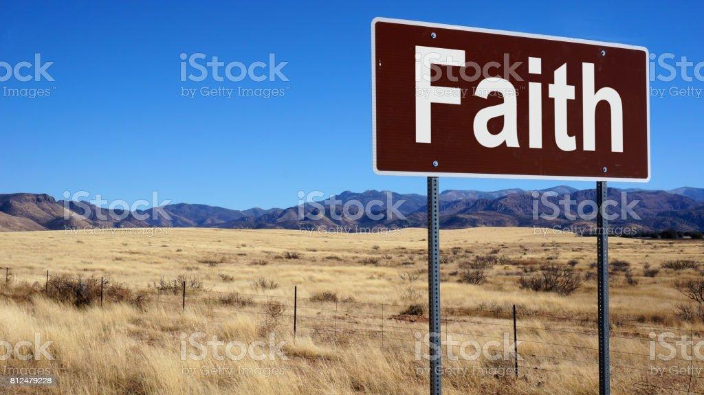 Faith road sign stock photo