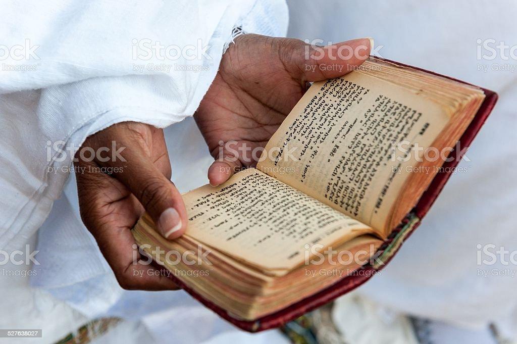 Faithful and amharic book stock photo