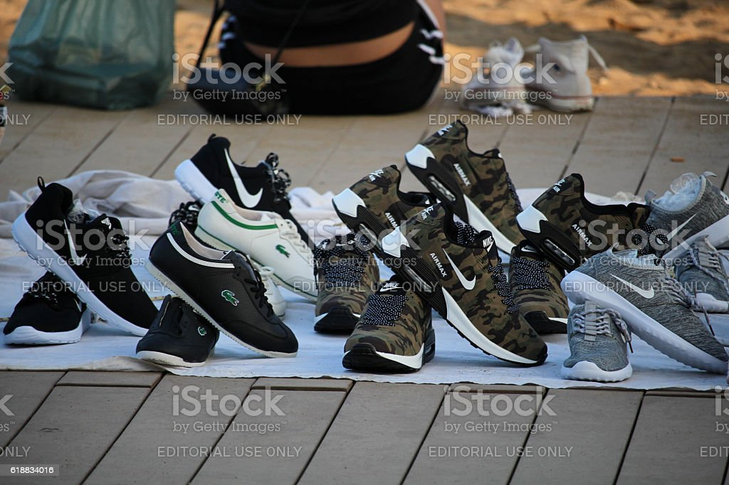 Fake brands sold on Barceloneta beach stock photo