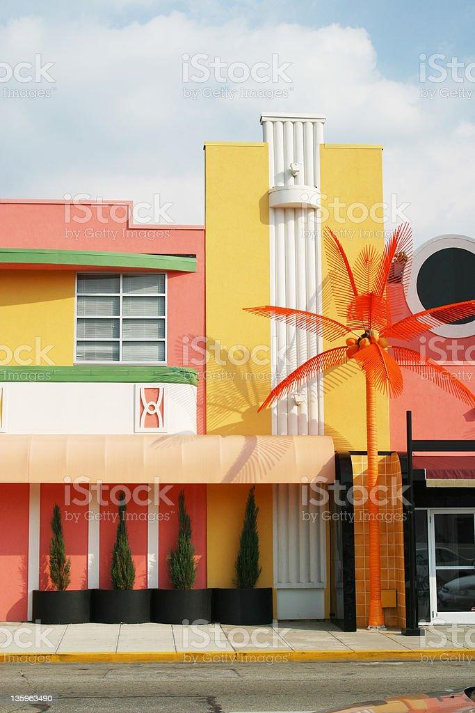 Fake Coconut Palm Tree & Building royalty-free stock photo