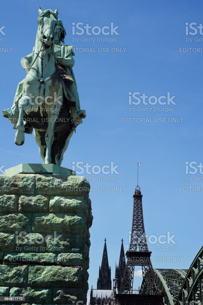 Fake Eiffel Tower and horse rider statue in front of Cologne Cathedral stock photo
