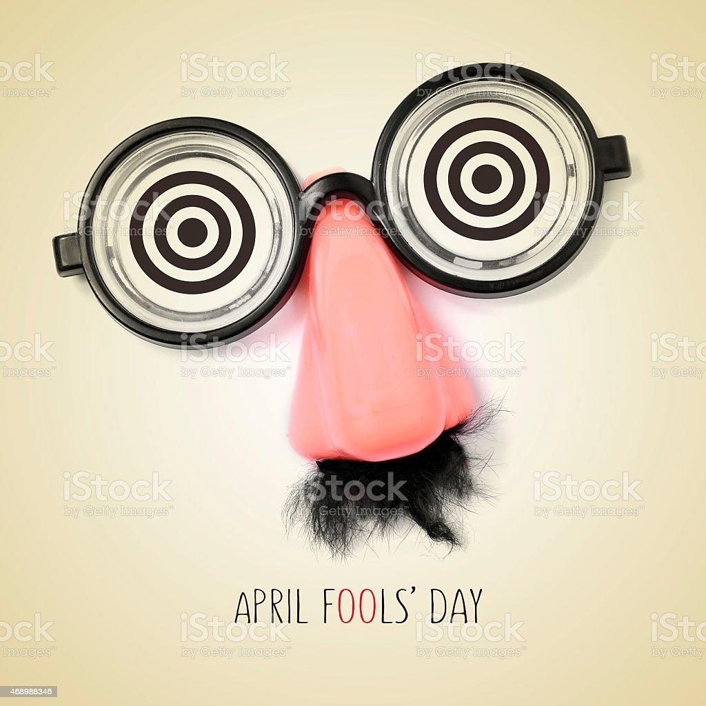 fake eyeglasses and text april fools day stock photo