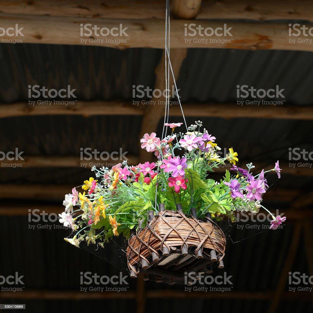 fake flower varicolored in hanging basket stock photo