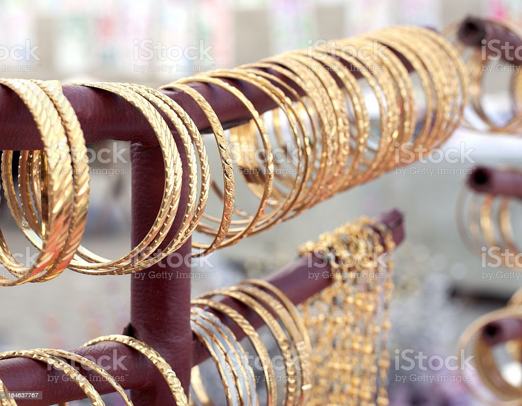 Fake gold bracelets stock photo
