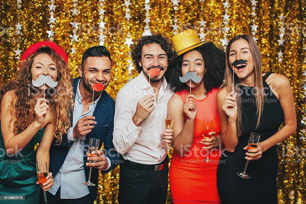 Fake moustaches and champagne stock photo
