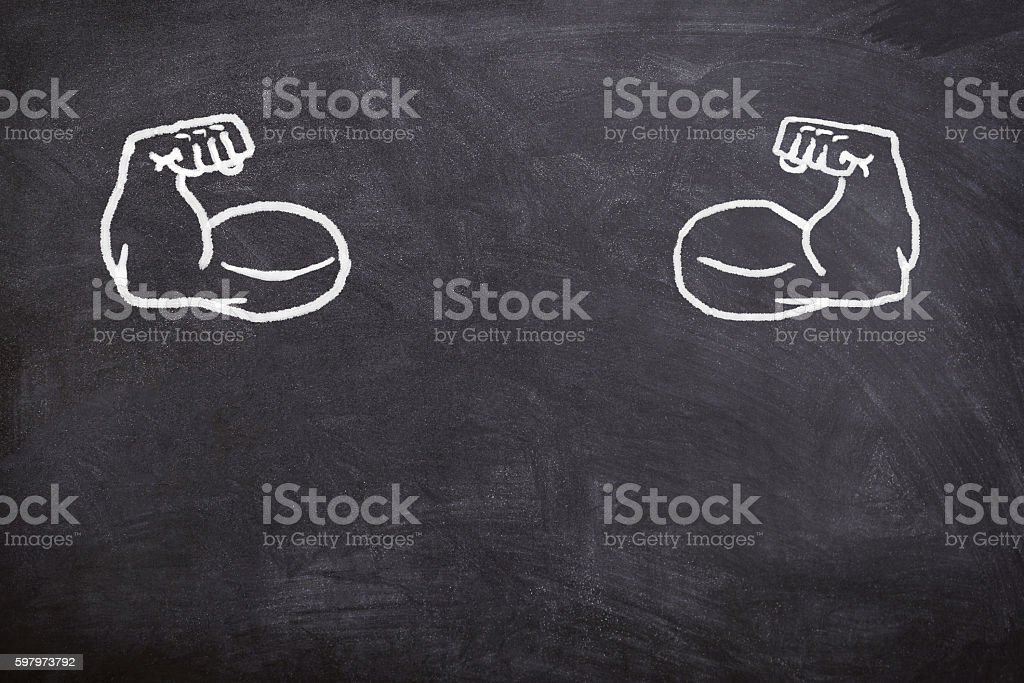 fake muscles drawn on the blackboard, stock photo